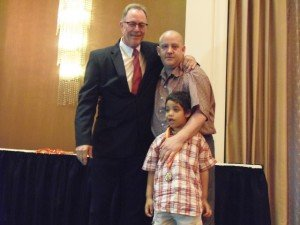 Kevin Weber (left), who has been at the Northern Home for almost 35 years, is seen with Kenny Stone and Kenny's son, Giovanni, after presenting Kenny with the Alumni Award at Northern's recent 10th Annual Children's Awards event at a hotel on City Line Avenue.