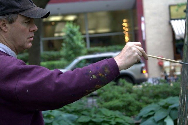 Charles Cushing, the winner of last year's Plein Air art competition in Chestnut Hill, is seen here painting in Rittenhouse Square.