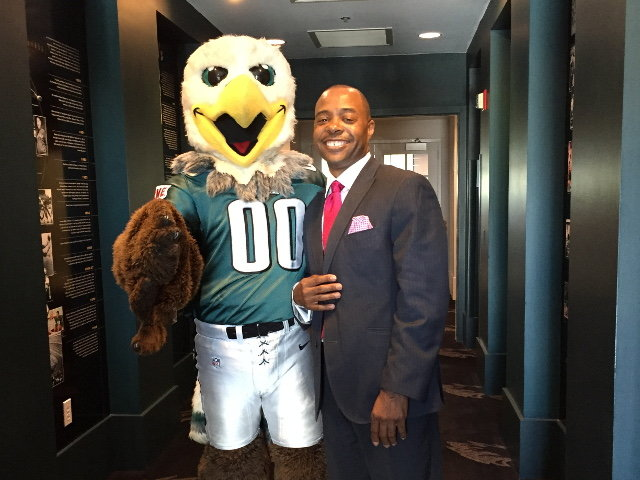 Jawara Griffin (right) is seen with Swoop, the Philadelphia Eagles' mascot, at the 11th Annual Children's Awards, where he was recently presented with the Alumni Award at Northern Children's Services in lower Roxborough. Griffin overcame a very difficult childhood to become a straight-A student in college and then a lawyer.