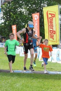 Conor crosses the finish line with his sons Aidan, 9, and Will, 7. This photo was taken at the finish line of a recent 70.3-mile triathlon in the Poconos.