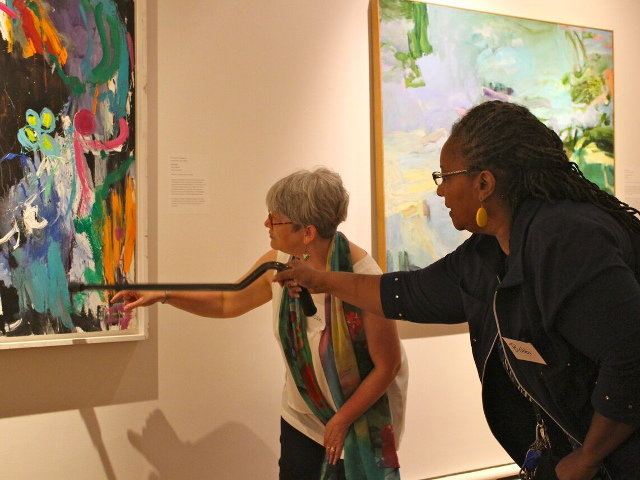 Susan Shifrin (left), executive director of ARTZ Philadelphia and Bobbi (last name withheld), a participant of ARTZ Philadelphia, admire a painting at Woodmere Art Museum. (Photos by Linda Ruth Paskell)