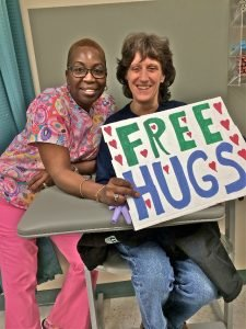Labcorp Technician Kathy Moody and Chestnut Hill resident Laura Flandreau are all smiles after receiving their free hugs.