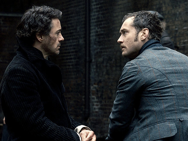 """SHH-FP-014.(L-r) ROBERT DOWNEY JR. as Sherlock Holmes and JUDE LAW as Dr. John Watson in Warner Bros. Pictures' and Village Roadshow Pictures' action-adventure mystery """"Sherlock Holmes,"""" distributed by Warner Bros. Pictures.."""