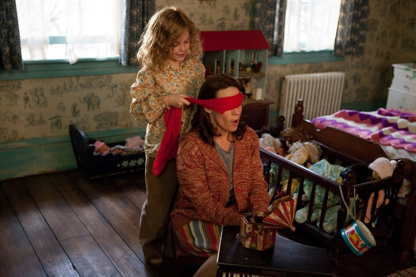 April (Kyla Deaver) blindfolds Carolyn (Lili Taylor) to start a particularly spooky scene in 'The Conjuring.'
