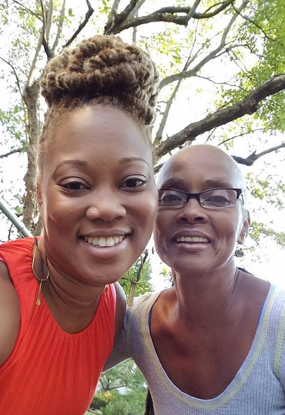 Nyeisha Cabiness (left) and Beverly Medley, owners of All the Way Live in Chestnut Hill.