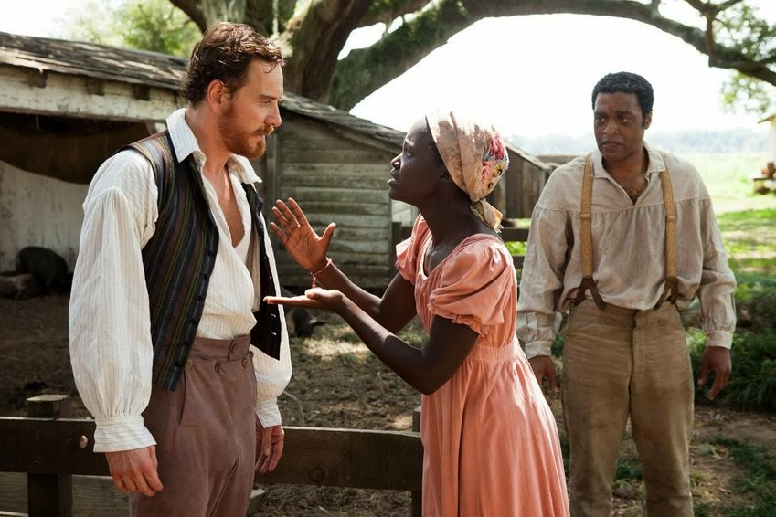 "Michael Fassbender, Lupita Nyong'o and Chiwetel Ejiofor in ""12 Years a Slave."""