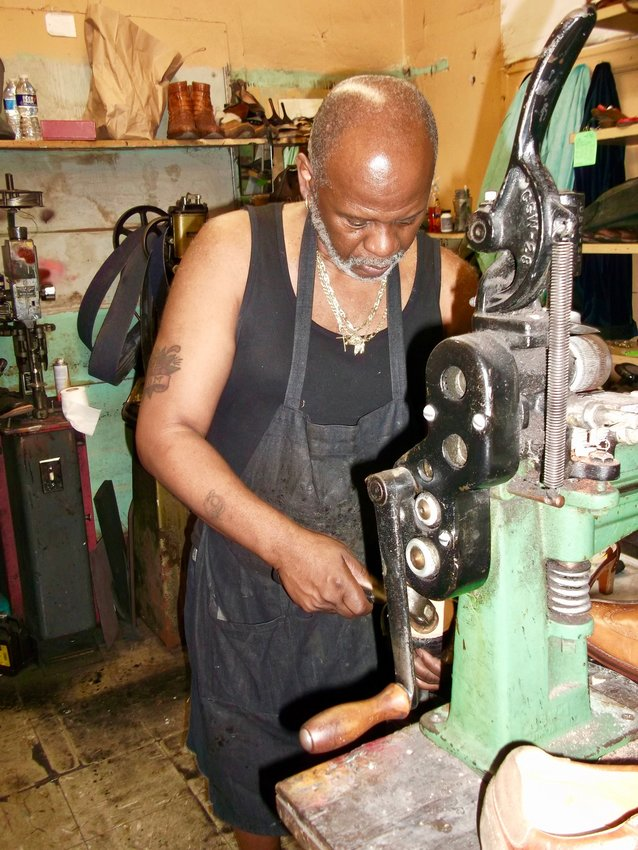 Willie Alston, 68, co-owner (along with Naeem Iddeen) of Ace Shoe Repair at 20 E. Mt. Airy Ave.