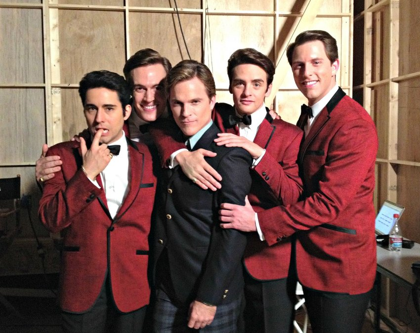 The fictional Four Seasons. The cast sang their songs live during filming.
