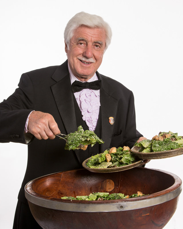 Alfio Gaglianese, with his signature bowtie and tuxedo, making one of his legendary tableside Caesar salads (of which he made more than 250,000).
