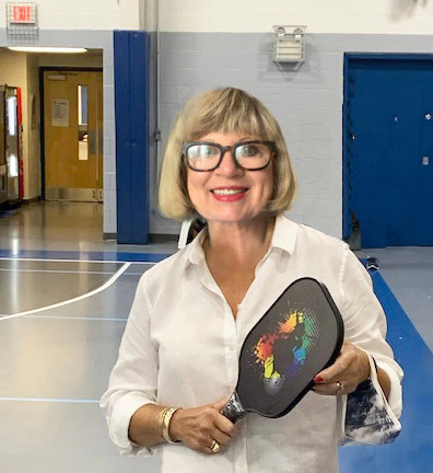 Debra Malinics, seen here at the Water Tower Recreation Center in Chestnut Hill, is an evangelical convert to the sport of pickleball.