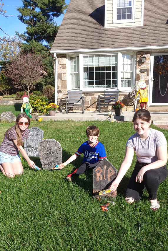 """Flourtown resident kids Lauren Posluszny, and Emmett and Penny Kline plan on doing a """"candy graveyard"""" for Halloween this year."""