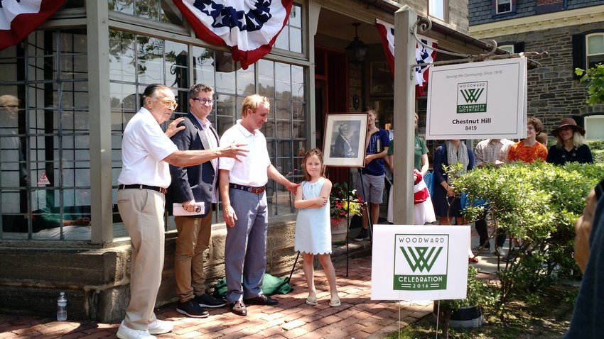 A celebration marked the dedication of the Woodward Community Center in June of 2016. At the dedication were (from left) Woodward center board member Will Detweiler, Elfant Wissahickon Realtor and Kismet Co-Work owner Chris Plant, Chuck and Hayes Woodward. (Photo by Pete Mazzaccaro)