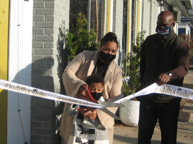 The first new store to open on Small Business Saturday was Buddha Babe, at 7101 Emlen St.  Owner Tina Spence Dixon, her son Baron Johnson and Philadelphia Councilman-at-Large Derek Green marked the opening with a ribbon-cutting ceremony. (Photo by Walt Maguire)