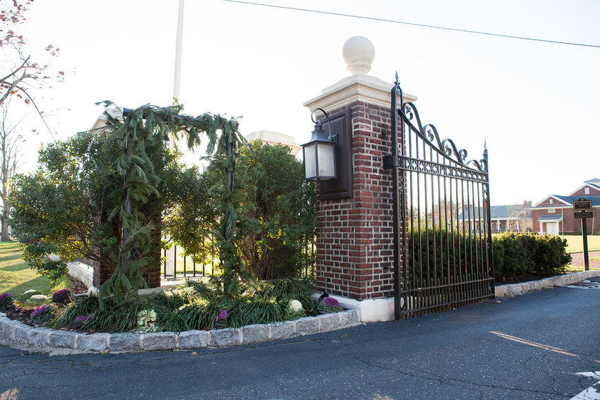 The Philadelphia Cricket Club logo was removed from its Willow Grove Avenue entrance. The logo was also removed from other public facing locations. (Photo by Emilie Krause)
