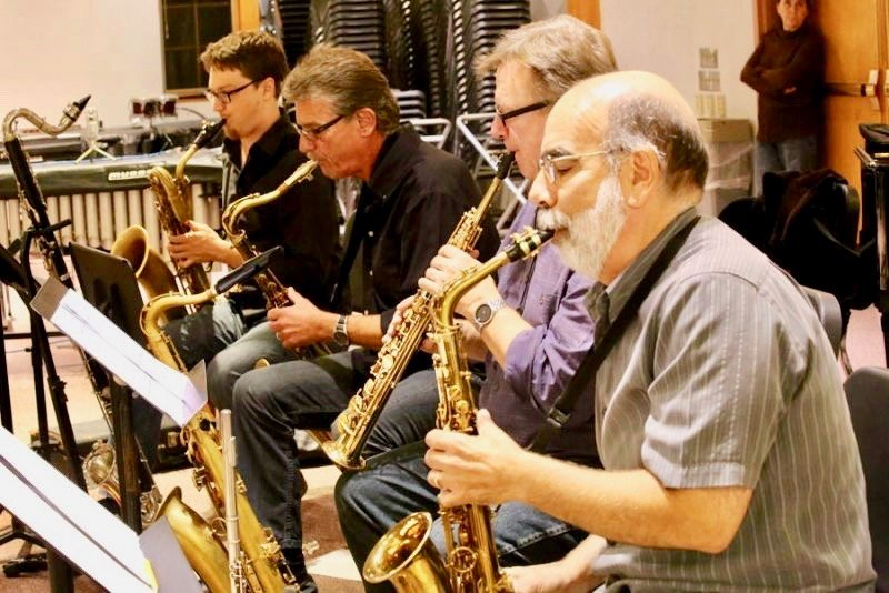 Len Pierro (right), of Flourtown, rehearses with three other local sax players — Mark Allen, Bob Howell and Ron Kerber.