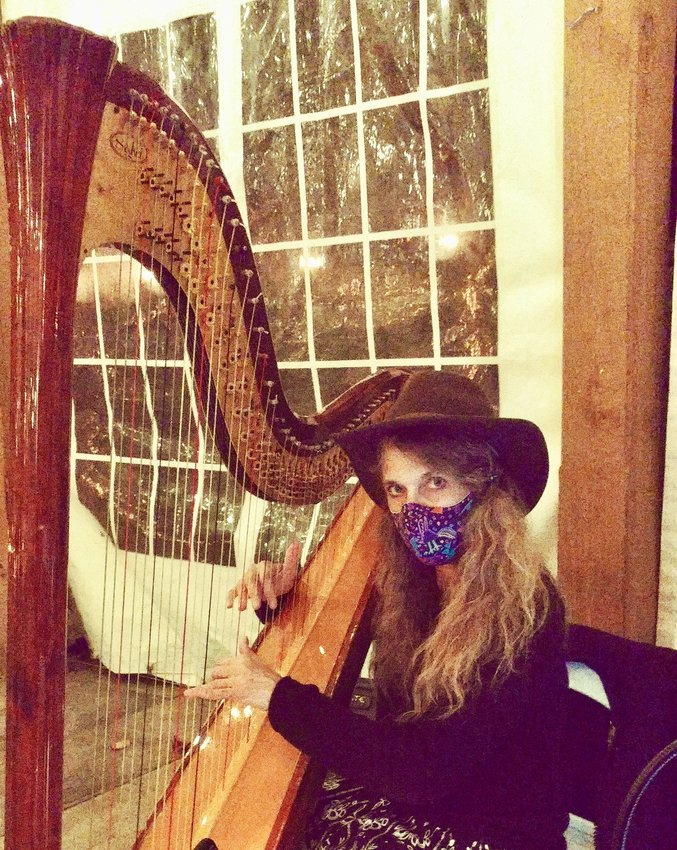 """Ellen Tepper has performed outdoors a few times recently, including at Valley Green Inn, where listeners were distanced and masked. """"Luckily,"""" she said, """"the harp is a great barrier!"""""""