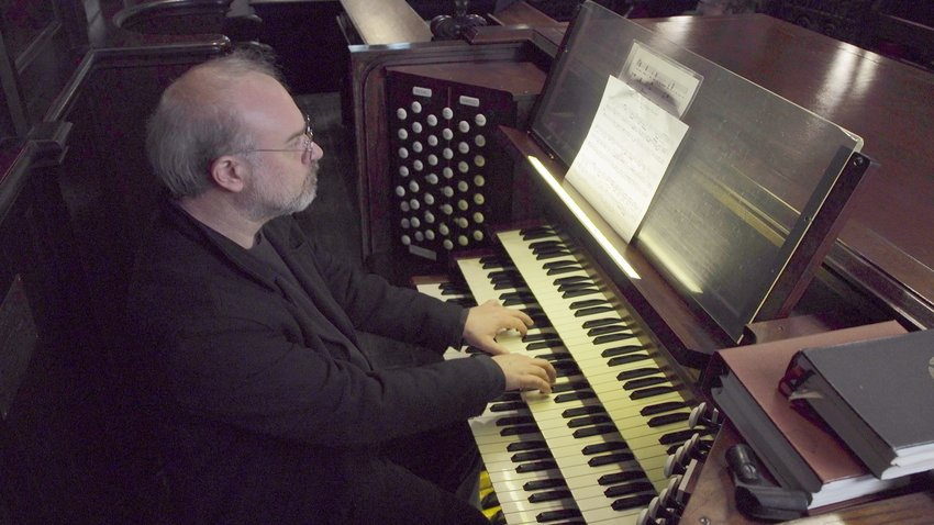 Matthew Glandorf plays the organ during Choral Arts' New Years Eve performance.