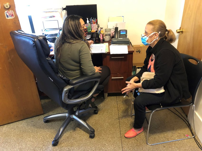 Benefits Outreach Specialist Jasanil Garcia (left) assists a client to find and apply for benefits for which she may be eligible, at United Communities of Southeast Philadelphia.
