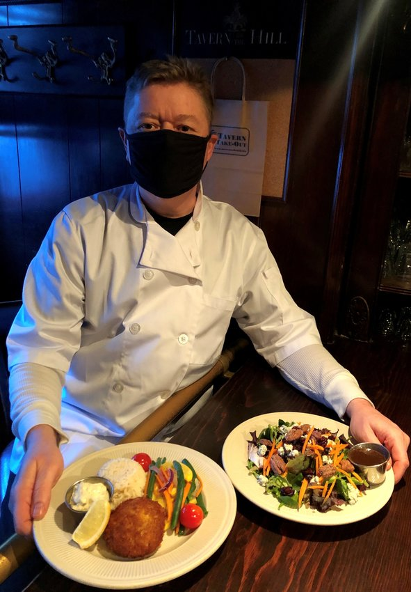 Tavern on the Hill Chef Gerard Strenger with two of many of the local restaurants signature dishes: The Crab Cake Entrée and The Cranberry Pecan Salad.