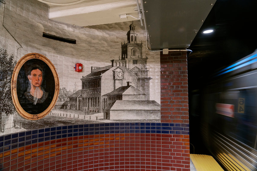 A portion of the Portal to Discovery mural at Independence Hall Station depicting an early rendering of Independence Hall with unknown female portrait, 2020, by Tom Judd (Courtesy of the artist)