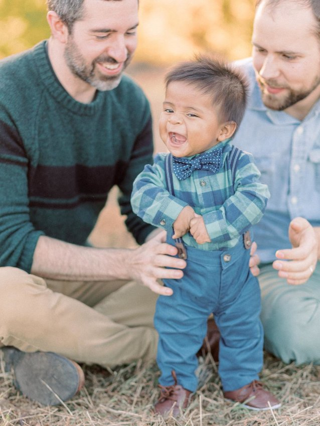 Adoptive parents Alex Macnow (left) and Nathan Renner-Johnson with their son Gregory Macnow. (Photo courtesy of Alex Macnow and Nathan Renner-Johnson)