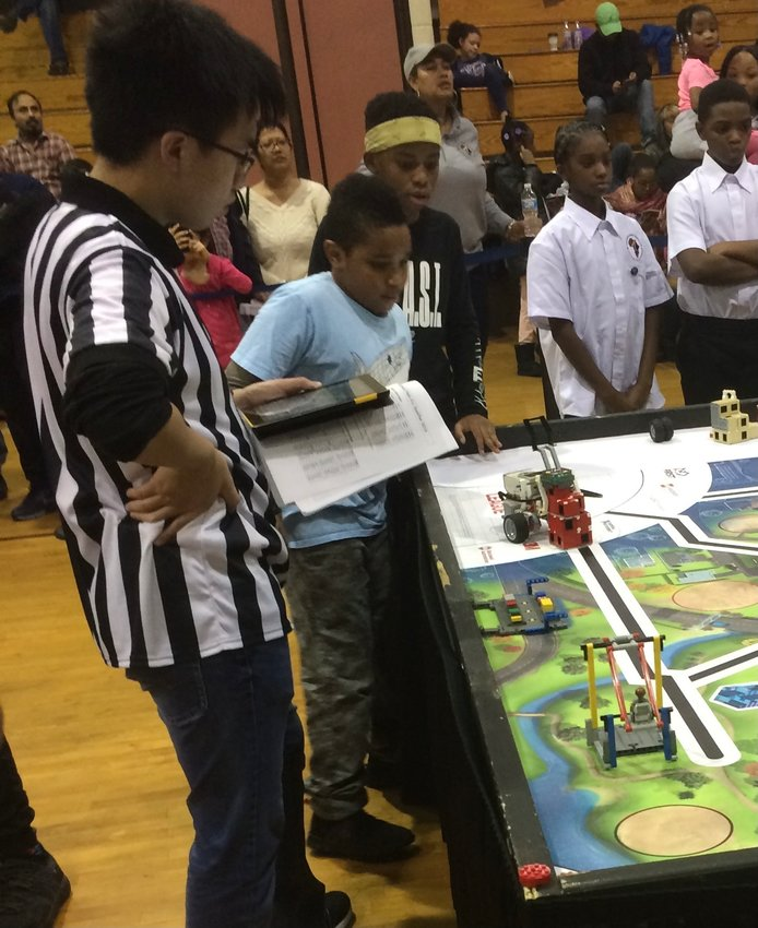 Jenks Robotics team members Andrew Kirkman and Shayne Cottle during the 2019-2020 FIRST LEGO League Challenge.