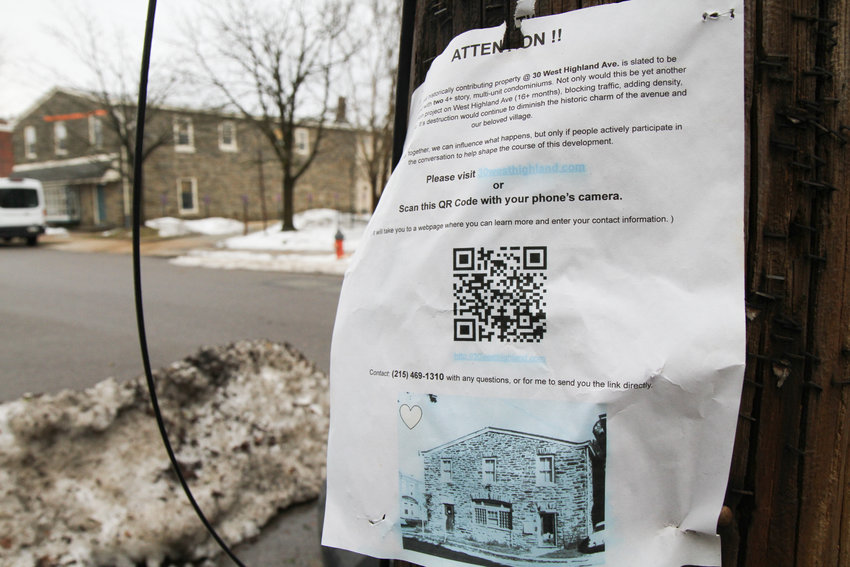 Flyers posted on poles around the neighborhood directed people to a website collecting opinions about 30 W. Highland Ave. More than 80 responded. (Photo by DB Fromm)