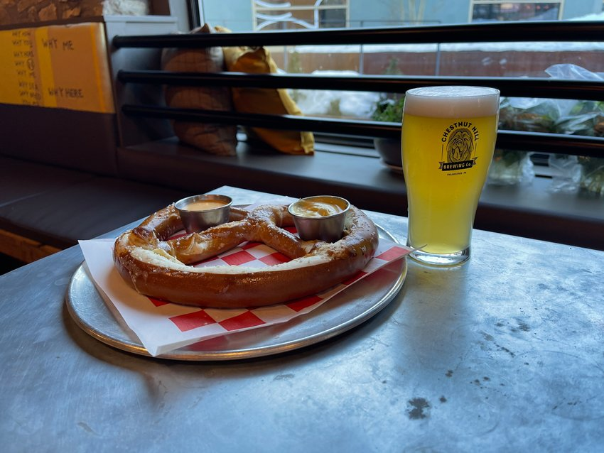 Pair a German-style lager, like Chestnut Hill Brewing Company's Jaromir, with a Bavarian pretzel dipped in mustard.
