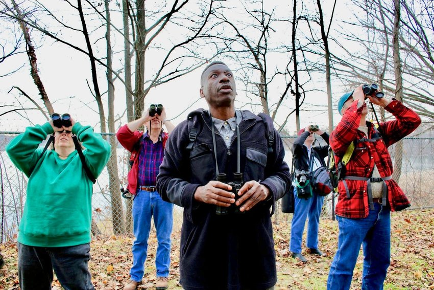 Keith Russell (center), an ornithologist who grew up in West Mt. Airy but now lives in Germantown, is seen here bird-watching with fellow members of the National Audubon Society. (Photo courtesy of National Audubon Society)