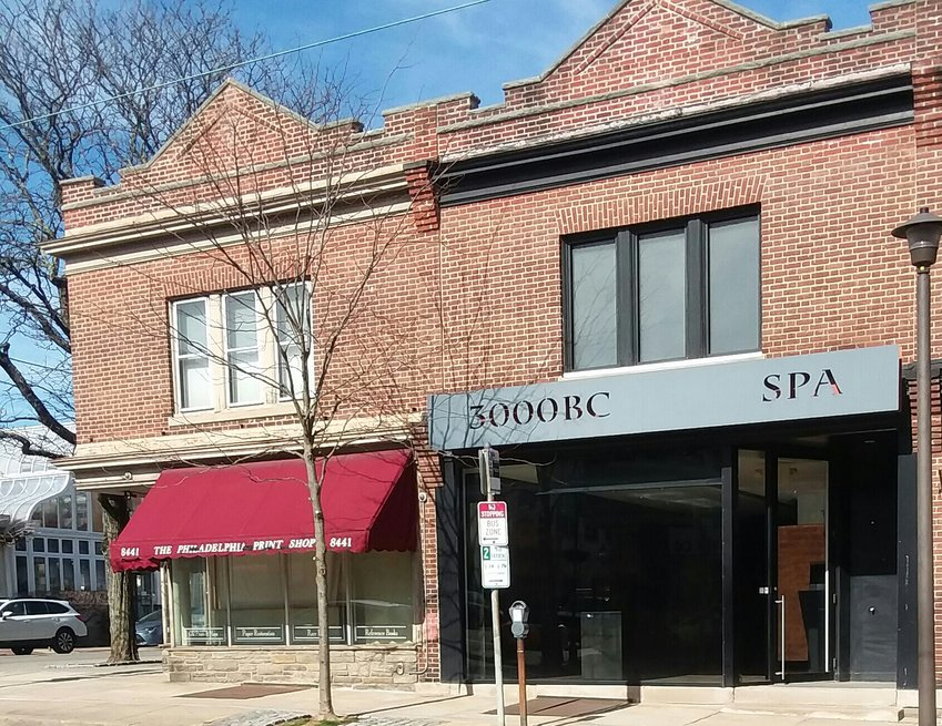 The buildings that housed the Philadelphia Print Shop and 3000 BC Spa next door on the 8400 block of Germantown Ave. are both vacant now. (Photo by Stacia Friedman)