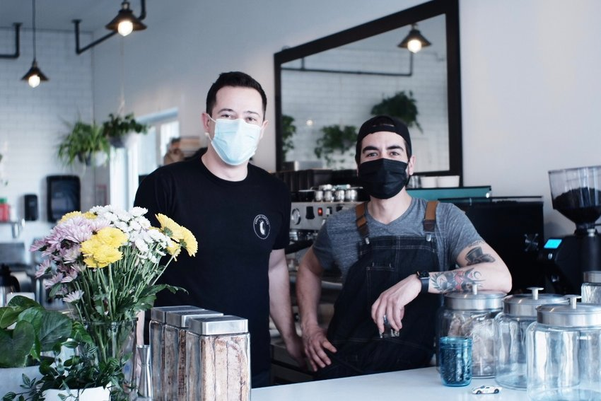 Will Maggs (left) and Andres Maldonado opened Adelie Coffee at 6610 Germantown Avenue on February 15, 2020. It's now open 8-3 every day. (Photo courtesy Adelie Coffee).
