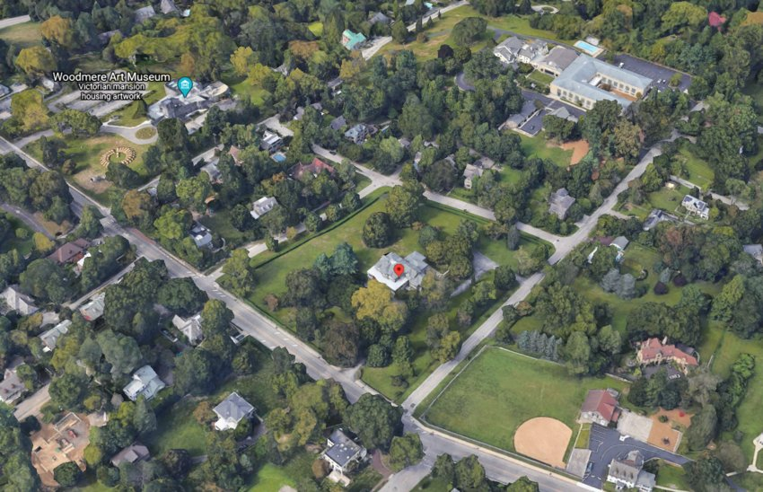 St. Michael's Hall (marked by a red pin) can be seen here amid its canopy of trees, occupying a four-acre block in Chestnut Hill. Woodmere Art Museum, located close by to the left in this image, hopes to purchase St. Michael's Hall for expansion. (Image: Google Earth)