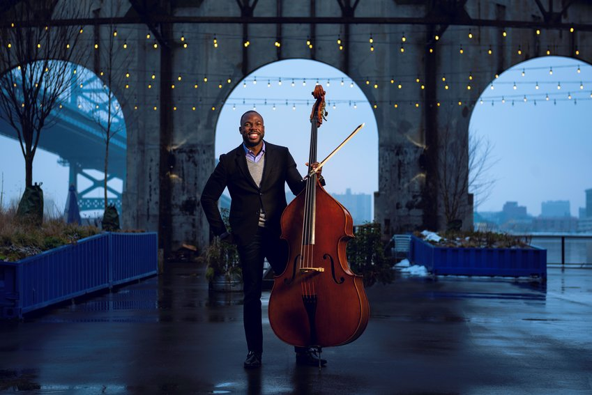Associate principal double bassist Joseph Conyers spoke before the Philadelphia Orchestra's performance, explaining the repertoire the orchestra was about to play.