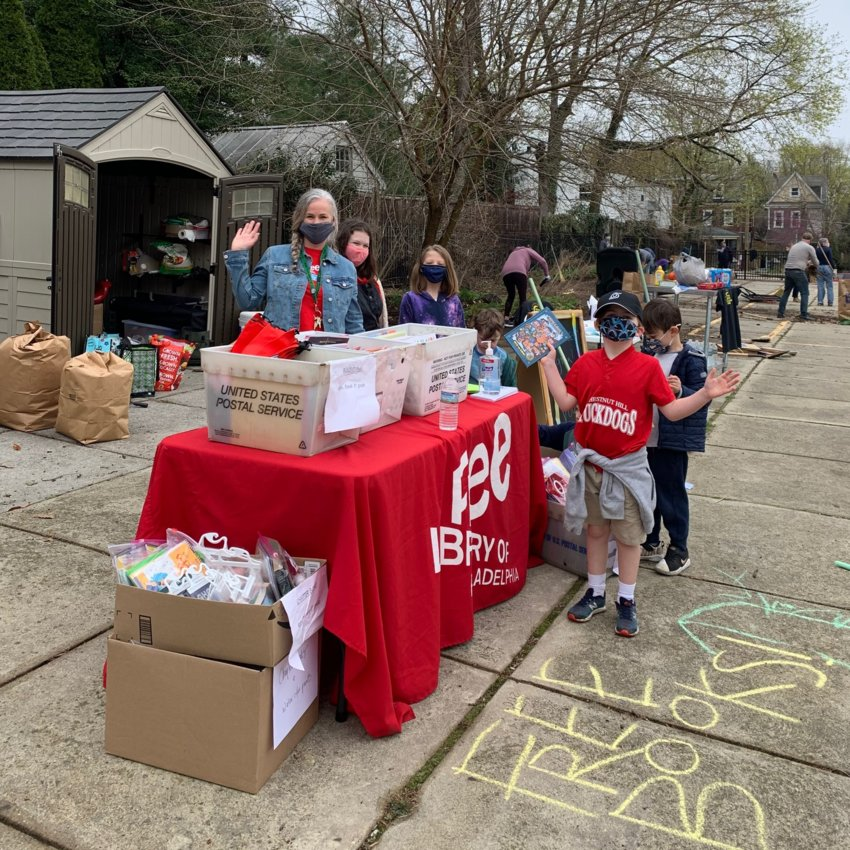 Prather Egan O'Donnell, Librarian at the Chestnut Hill Library, with a group of neighborhood children at the Philly Spring Cleanup Day.