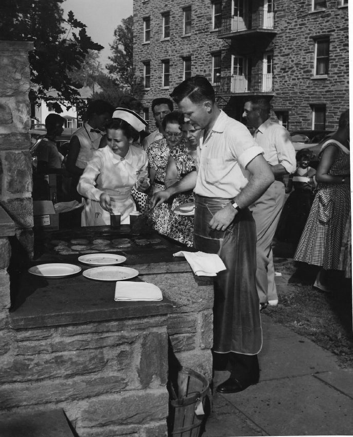 This September 7, 1954, photograph of a barbecue reception for a new class of student nurses was taken at Chestnut Hill Hospital. Mrs. Geraldine Ellis, Assistant Director of Nursing, is visible at the center of the photograph. The other people in the photograph are unidentified.   (Photo courtesy of the Chestnut Hill Conservancy)