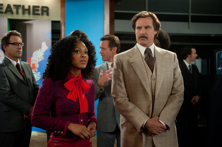 "Megan Good and Will Ferrell in ""Anchorman 2."""