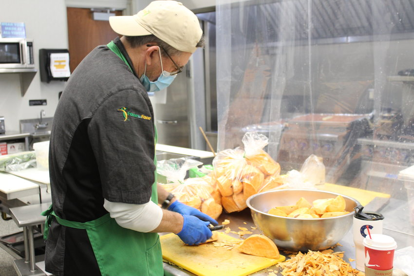 Volunteer Pat Kenney helping to prepare good recently got those in need at Face to Face.