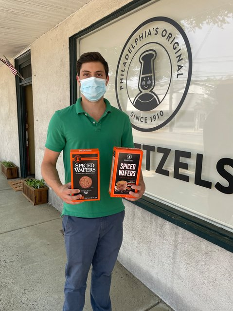 Sweetzel's owner Rob Borzillo with the old (left) and new (right) Spiced Wafer boxes.