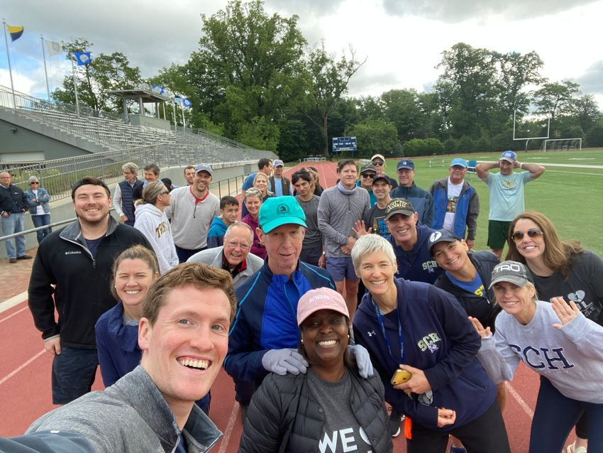 Hines (center, with hat)  is swarmed by his entourage of friends, and students—past and present. Many ran alongside the former SCH history teacher (and current track coach) for a segment of the marathon and then welcomed the long-distance hero back to the track which bears his name at Springside Chestnut Hill Academy's Maguire Stadium.