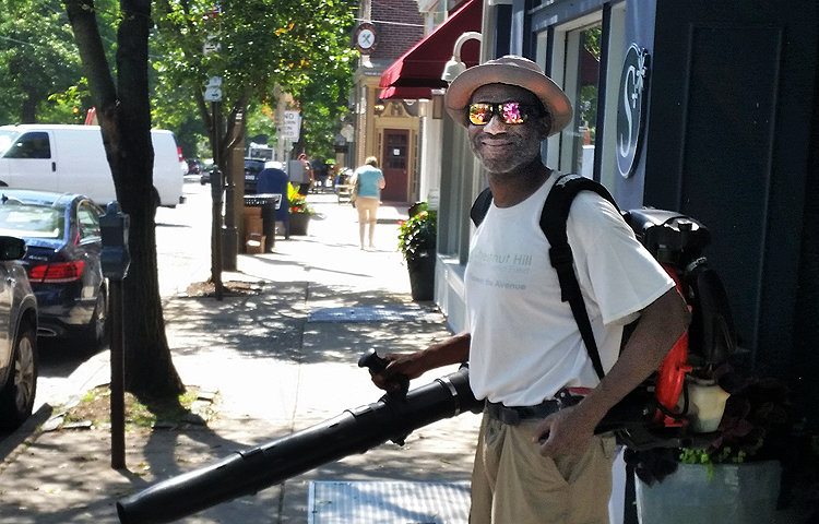 Chestnut Hill Business District employs a part-time crew of two: Eugene Hatcher (pictured) and Jonathan Dargan.