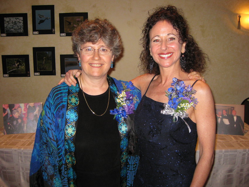 Windle (left) is seen during one of her poetry readings at a center city salon run by classical music composer Andrea Clearfield (right), who created three choral pieces for Windle's poems.
