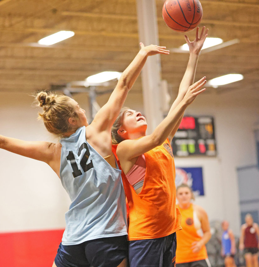 CHC freshman Morgan Sterner (right) of Team Orange manages to get off a shot against Ava Morrow of Team Sky Blue (Holy Family University).  (Photo by Tom Utescher)