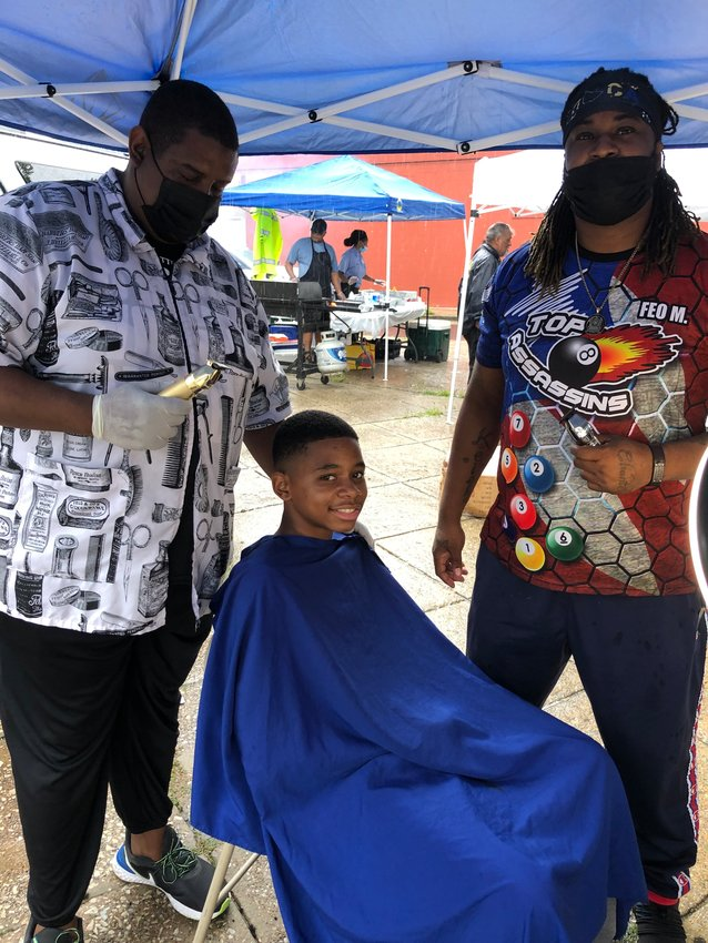 Barber teachers from the Germantown-based Pennsylvania Barber School provided free haircuts to prepare students for the new school year at the Unity in the Northwest Community Celebration on Saturday, August 28.