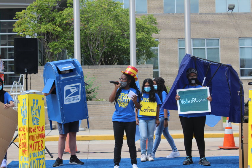 Teens performing with Spiral Q mailbox and polling booth puppets. After the November election, another one of Spiral Q's mailboxes ended up in the Smithsonian's National Museum of American History.