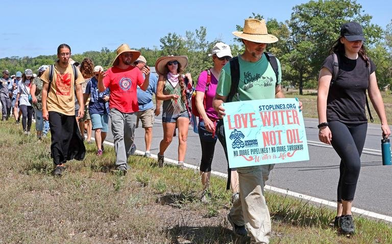 Water Protectors from the Treaty People Walk for the Water on their rest day in Brainerd, Minnesota. Chestnut Hill resident Elisabeth Torg (2nd row far right, purple shirt) participated in the Walk for several days in mid-August. The 14 day walk departed from the headwaters of the Mississippi River in Northern Minnesota and will reach the Minnesota state capitol building in St Paul on August 25th to ask for cancellation of the Line 3 pipeline permits.
