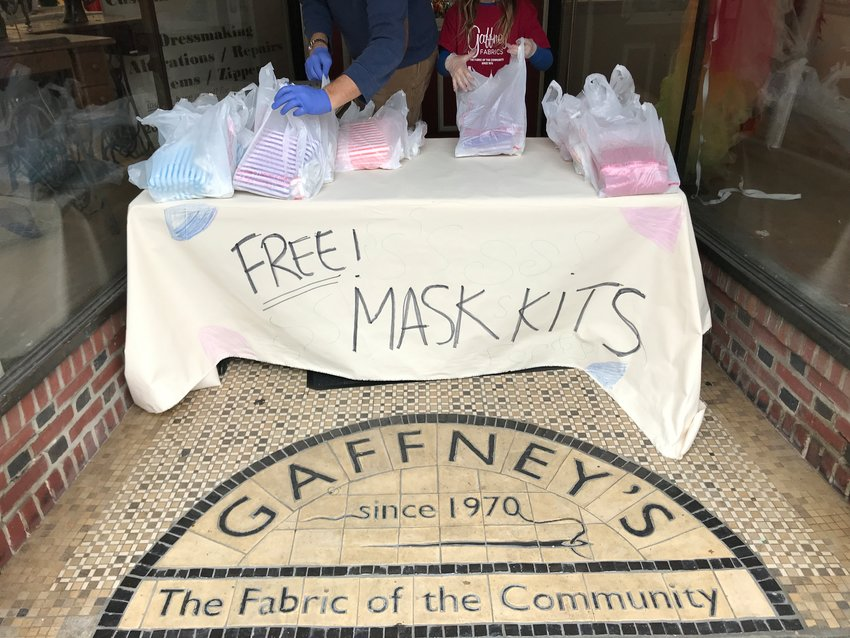 This photograph taken last spring by Kate Gaffney of Gaffney's Fabrics, 5401 Germantown Avenue, was obtained by Germantown Friends School student Ezra Stern, as part of his completion of the School's Documenting Pandemic Life in Germantown class. Shown is a table in front of Gaffney's, where 300 free mask kits that were assembled by Gaffney and her husband were given away to members of the community. (Collection of Chestnut Hill Conservancy)