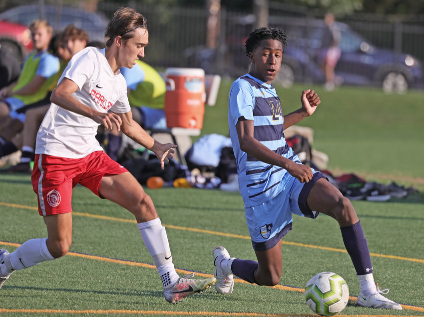 Controlling the ball on the left wing, SCH sophomore Zayd DeVeaux (right) senses the approach of a Parkland defender.
