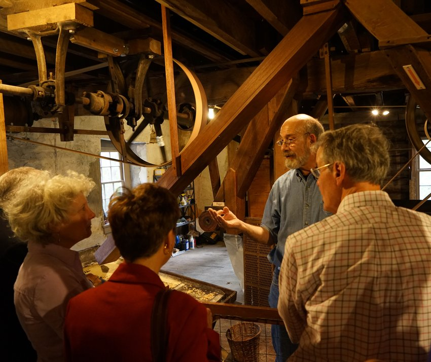 Guests can watch and interact with a tour guide as corn kernels are ground to make cornmeal in live demonstrations that take you back to the good old 19th century. (Pictured: Guide Craig SanPietro.)