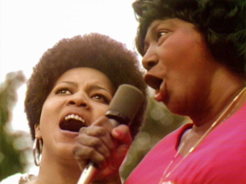 """Mavis Staples (left) and the legendary gospel singer Mahalia Jackson are seen in one of the many scintillating moments in """"Summer of Soul."""""""