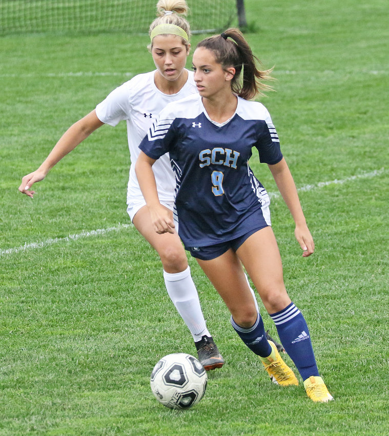 Junior Bella Brown controls the ball for the Blue Devils.